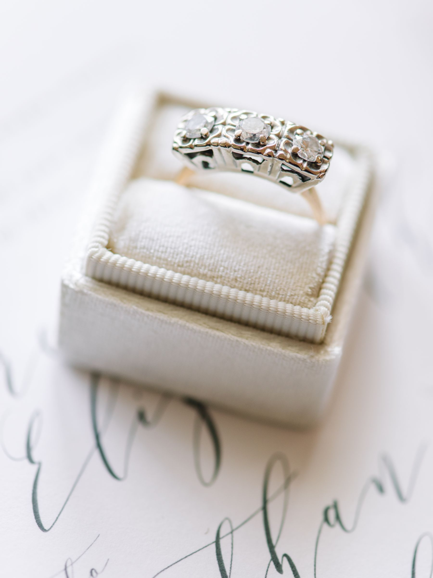 engagement ring in a mrs. box on wedding stationery