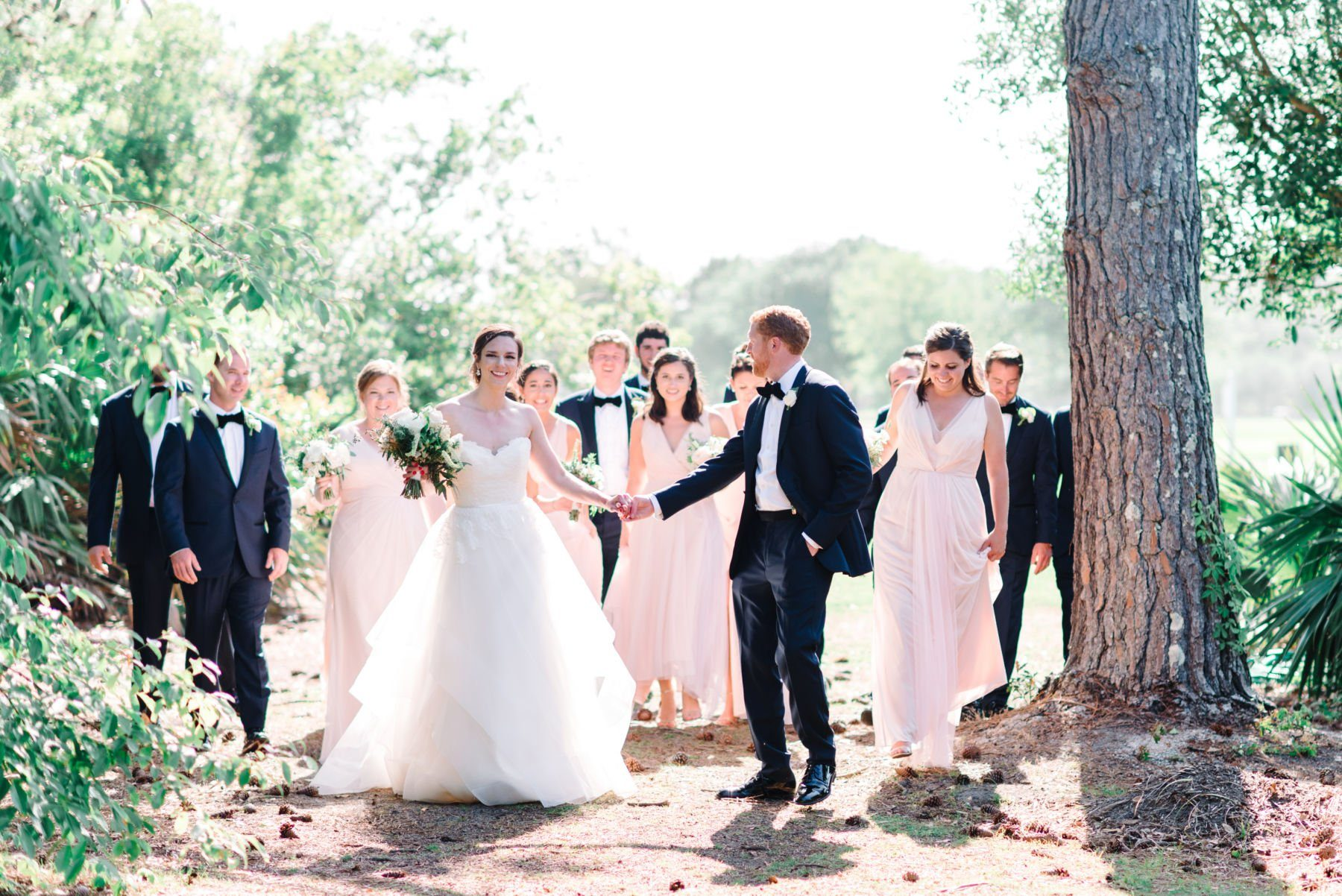 bridal party walking in the sunshine
