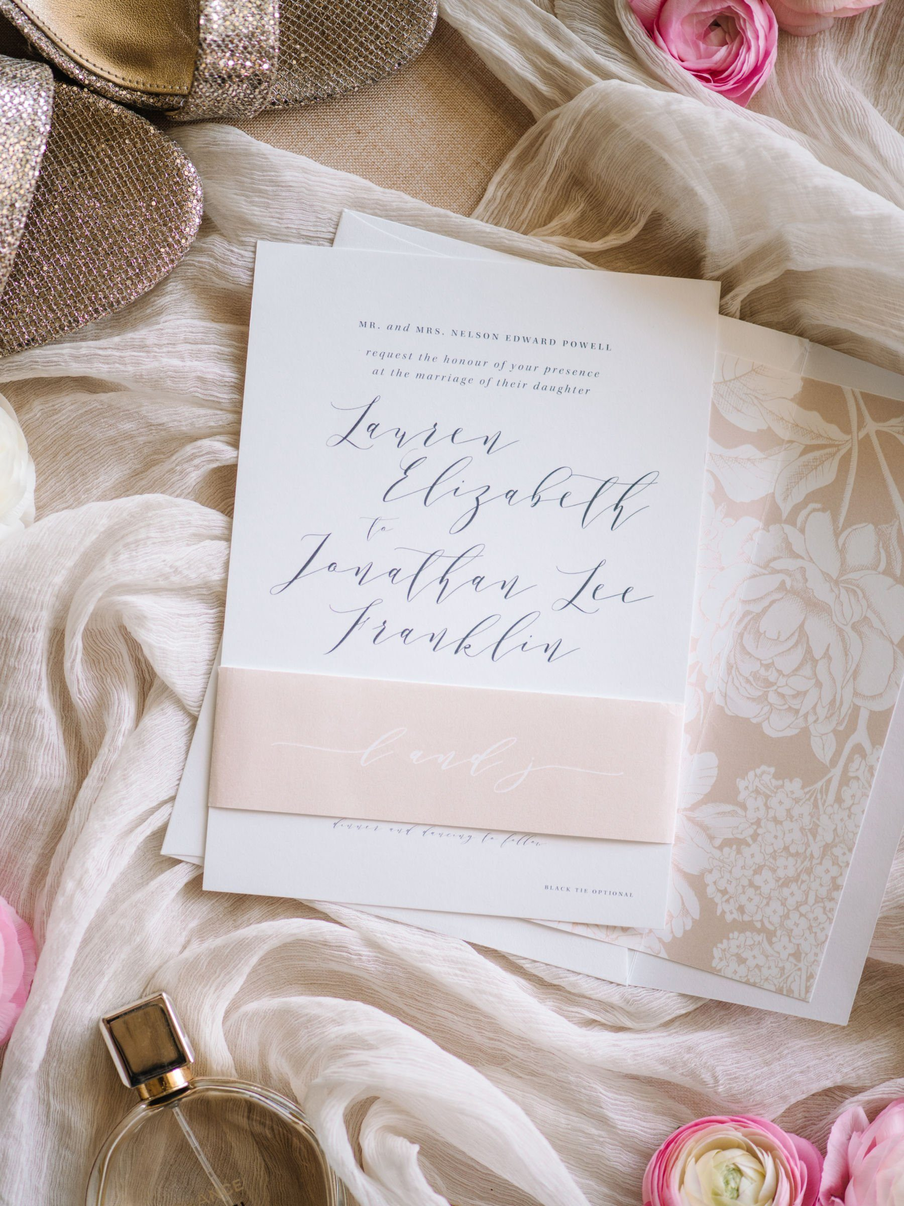 breathtaking wedding invitation with modern calligraphy and a rose gold wrapper and envelope liner