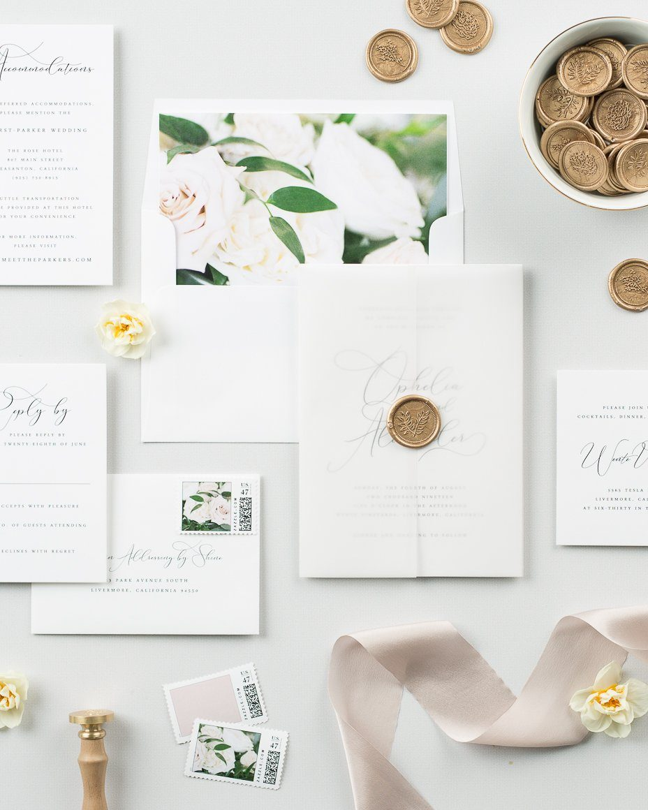 floral wedding invitations with a vellum jacket and gold wax seal