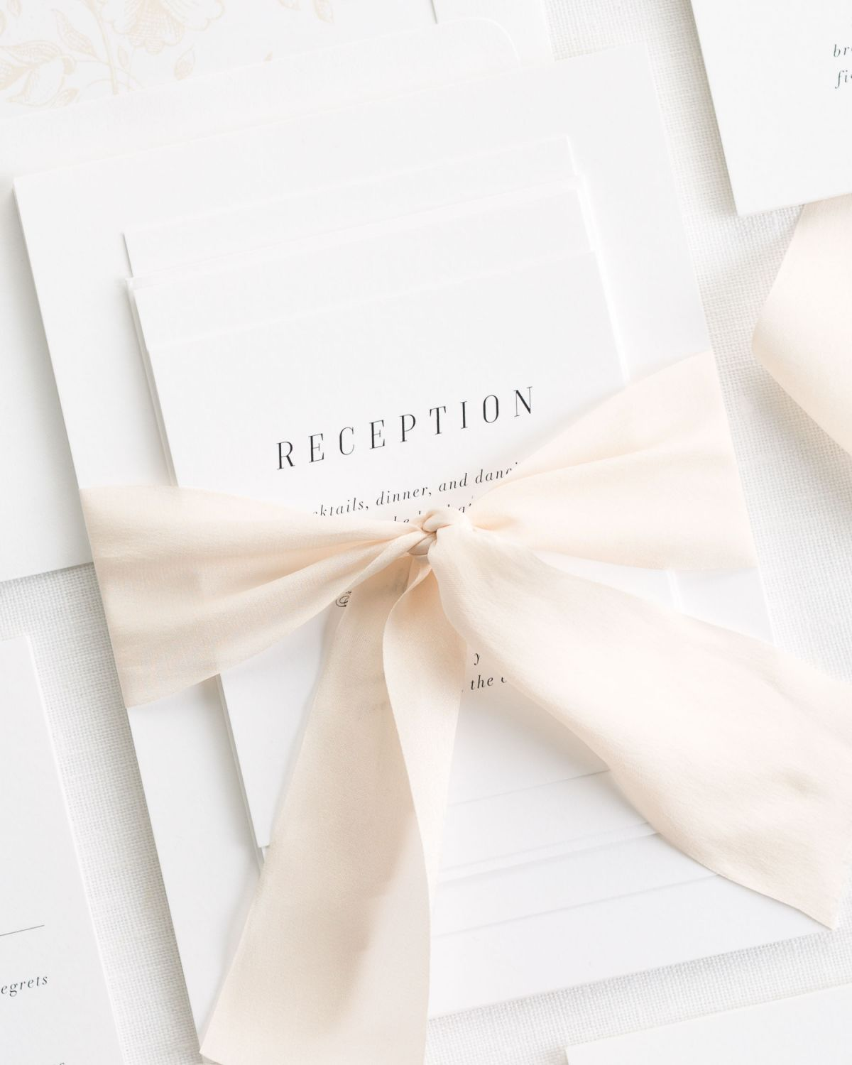 Complete wedding invitation suite with cashmere ribbon and enclosures