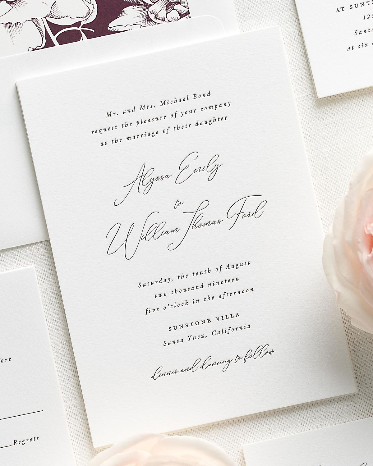 classic calligraphy letterpress wedding invitations with a dark purple liner