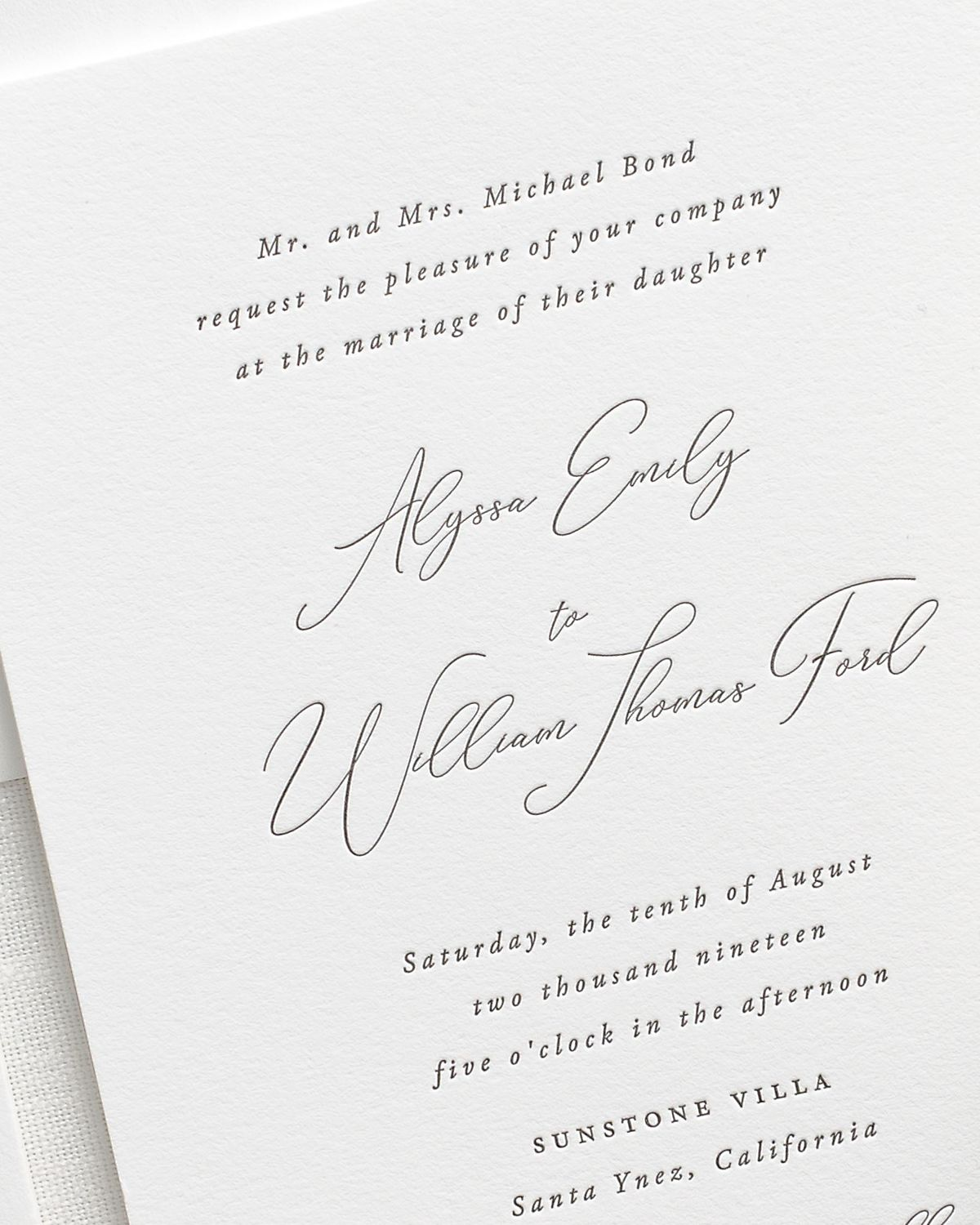 simple calligraphy letterpress wedding invitation close up