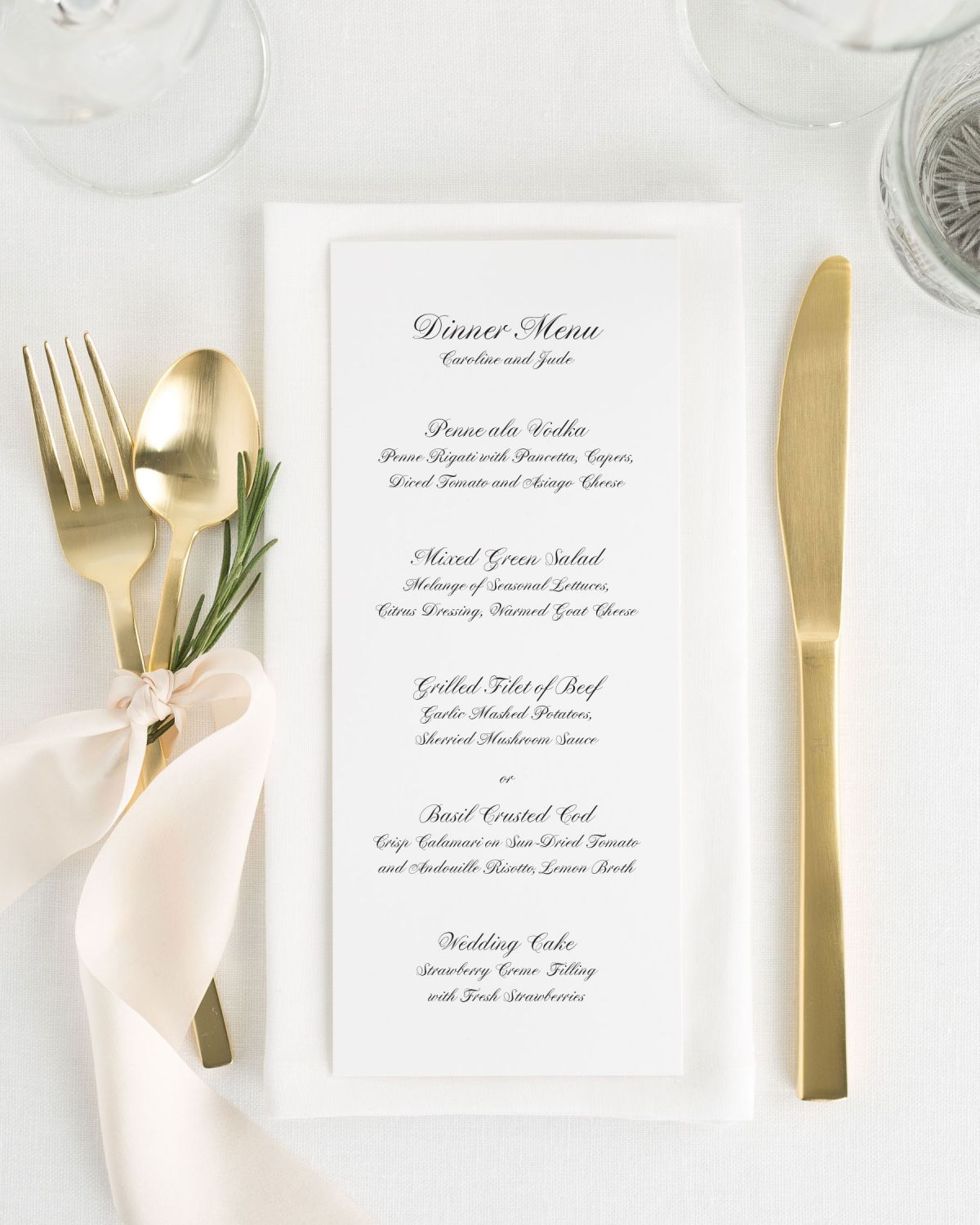 classic wedding menu with gold flatware and pink silk ribbon