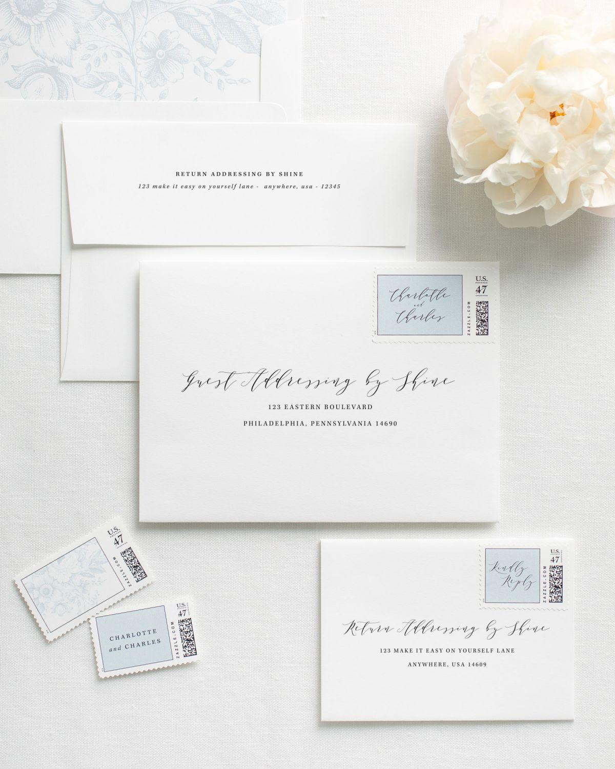 Guest Addressing Envelopes with dusty blue Custom Stamps