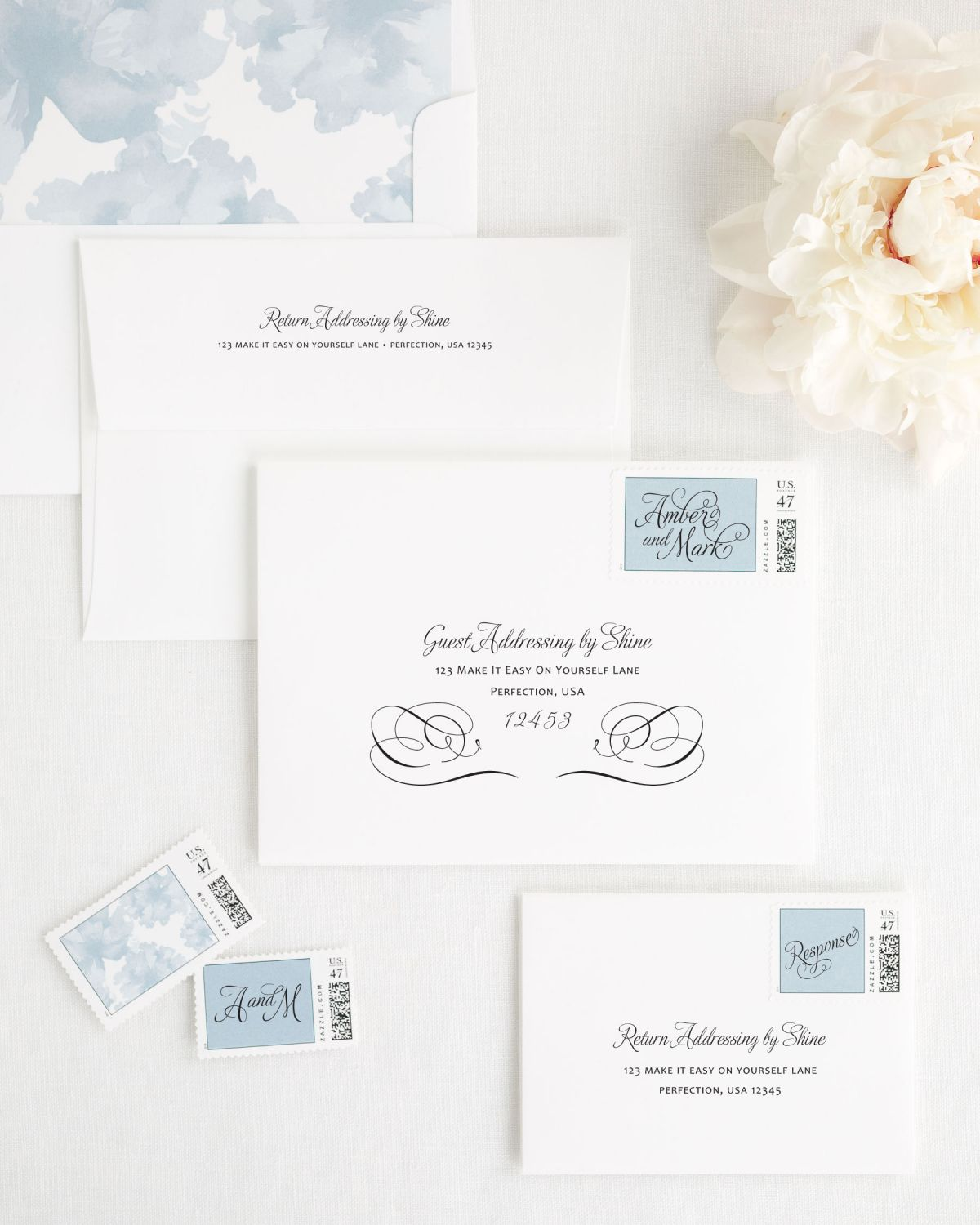 Wedding Invitation Envelopes with Dusty Blue Personalized Stamps and Watercolor Floral Liner