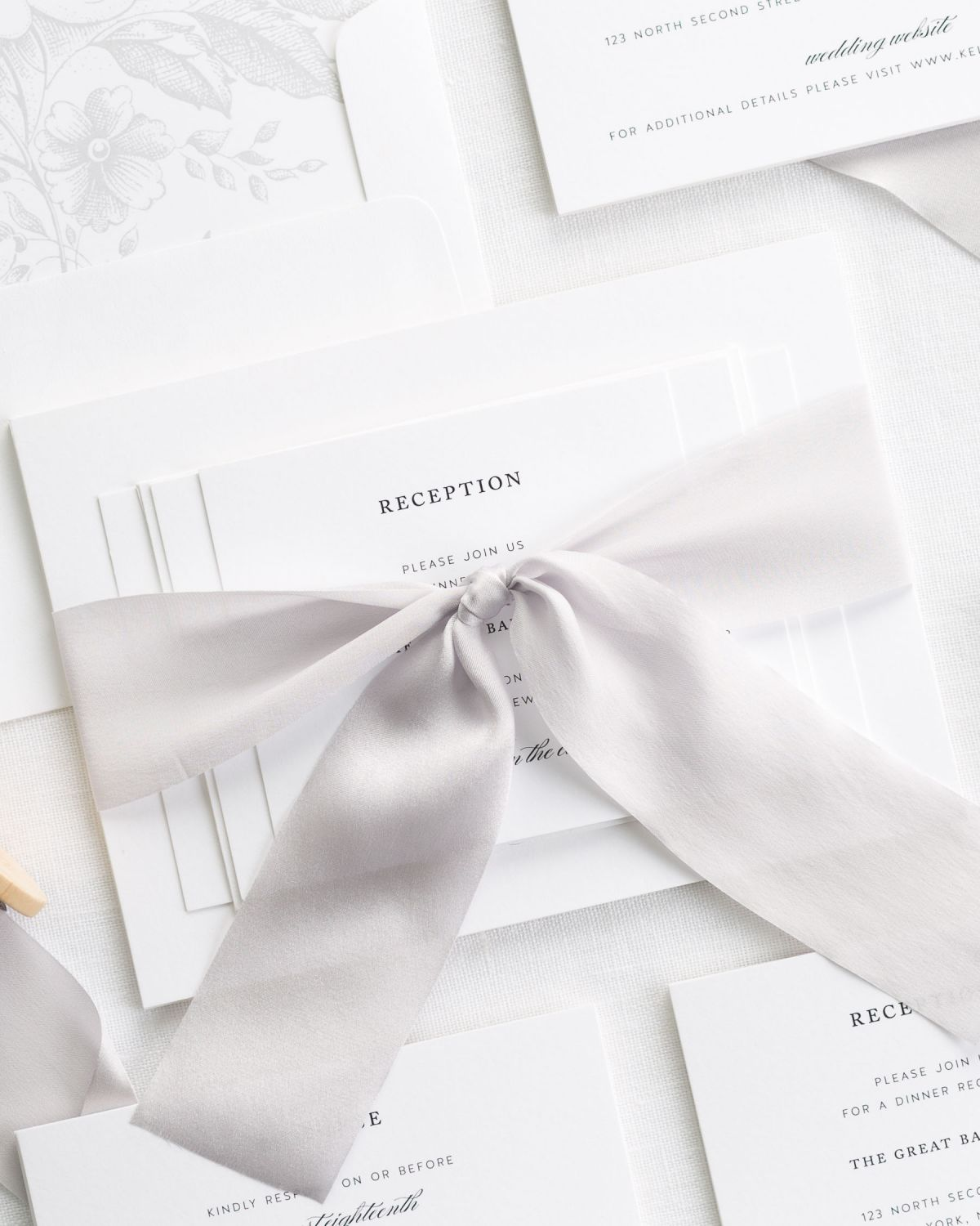 Silver Wedding Invitations with Silk Ribbon and a Gray Floral Envelope Liner