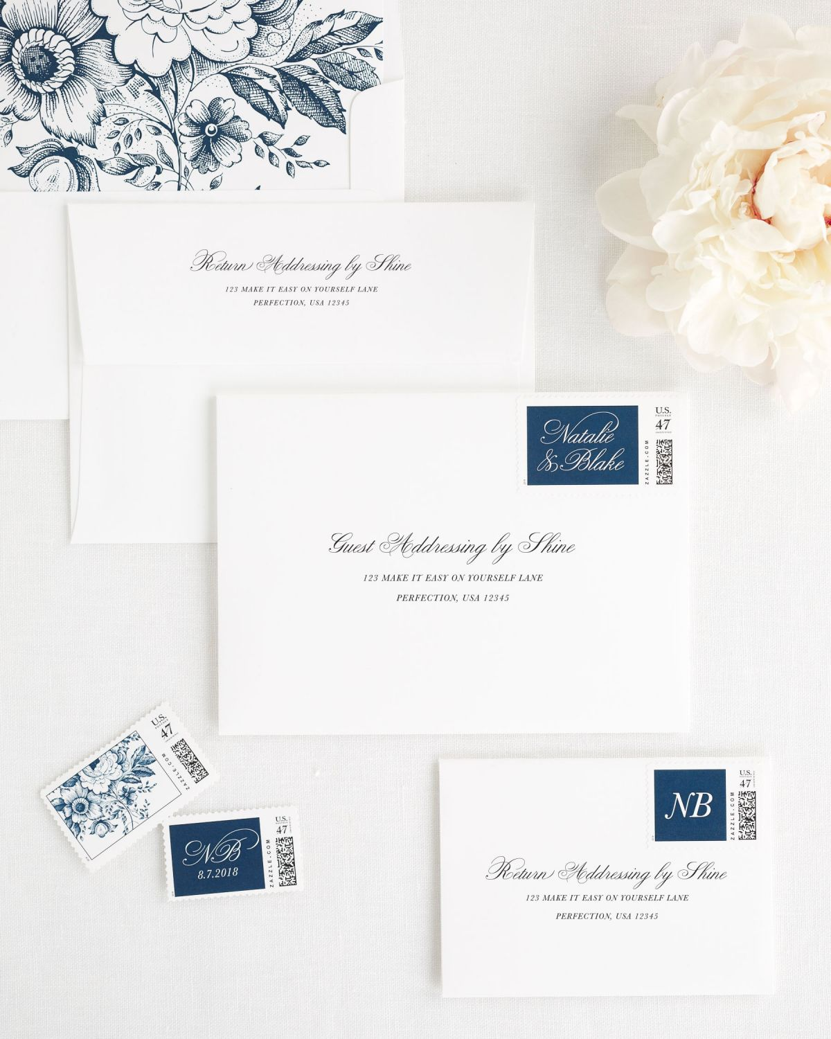 wedding envelopes with guest addressing and custom stamps in navy
