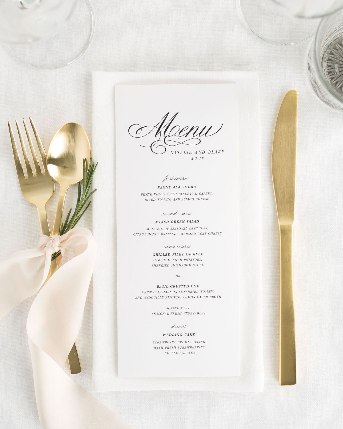 classic script wedding menu with gold flatware