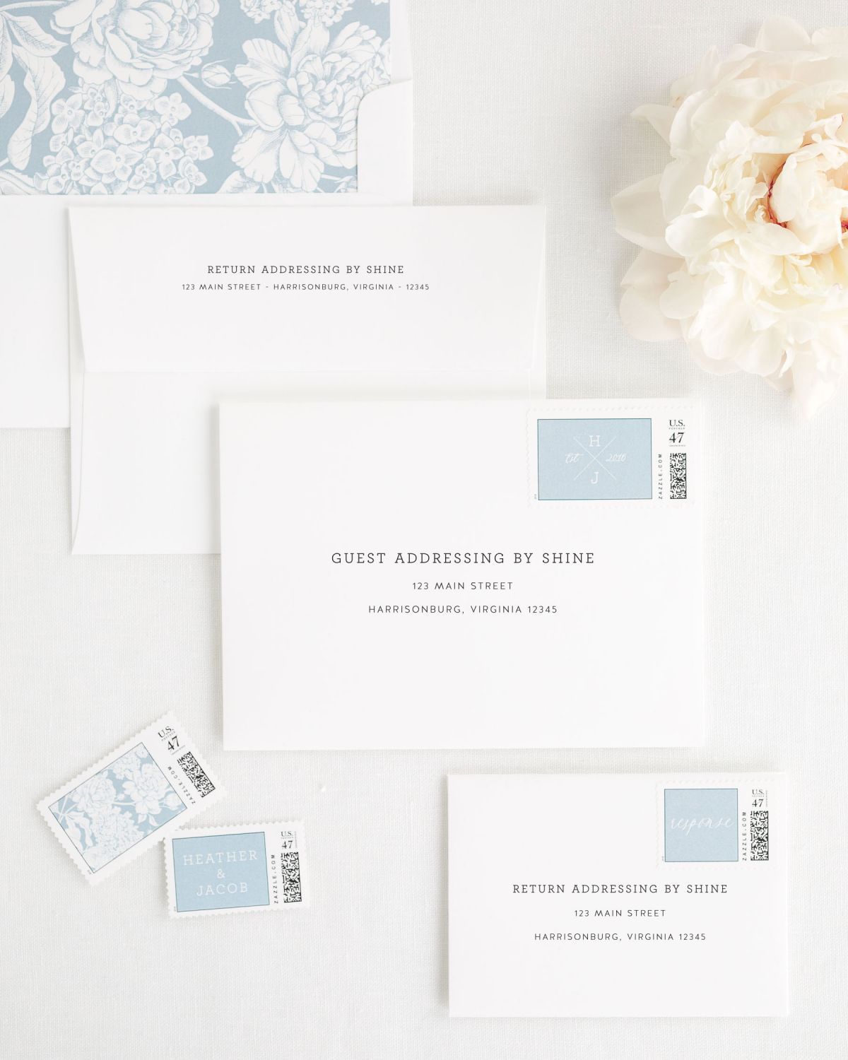 Wedding Invitation Envelopes with Dusty Blue Custom Postage and Floral Liner