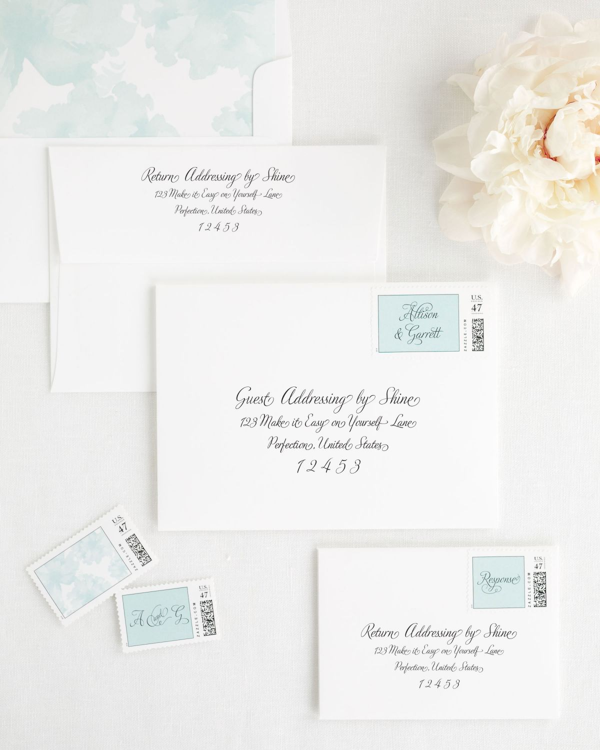 Wedding Invitation Envelopes with Mint Custom Stamps and Floral Watercolor Liner