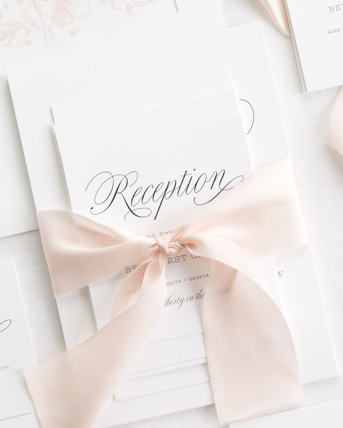Rose Gold Wedding Invitations with Silk Ribbon and a Floral Envelope Liner