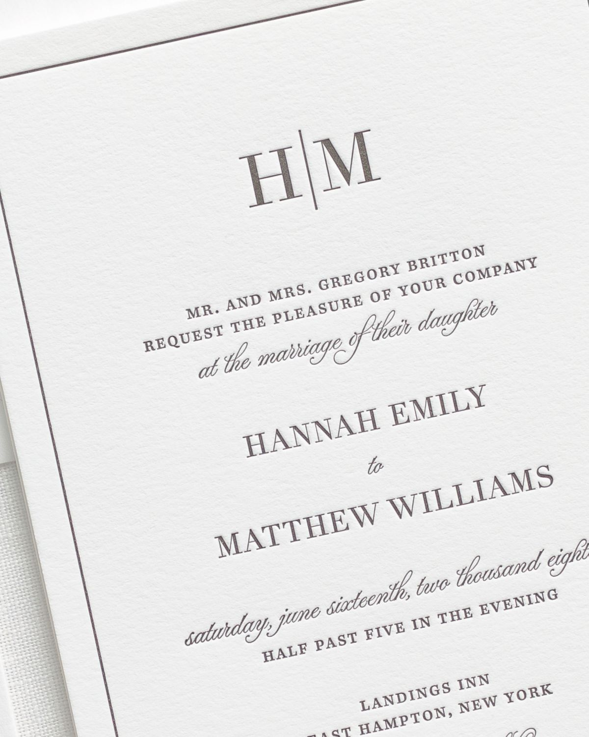 bordered and sophisticated letterpress wedding invitation close up