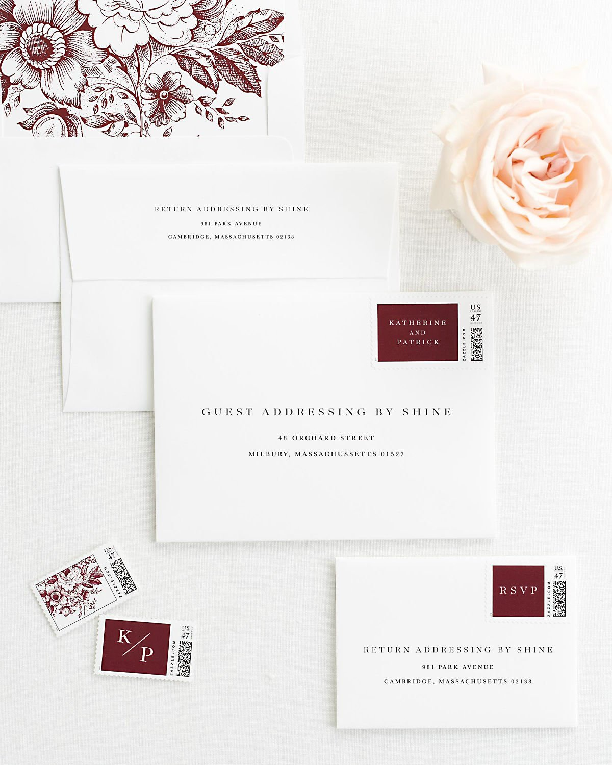 wedding envelopes with guest addressing and custom stamps in cabernet