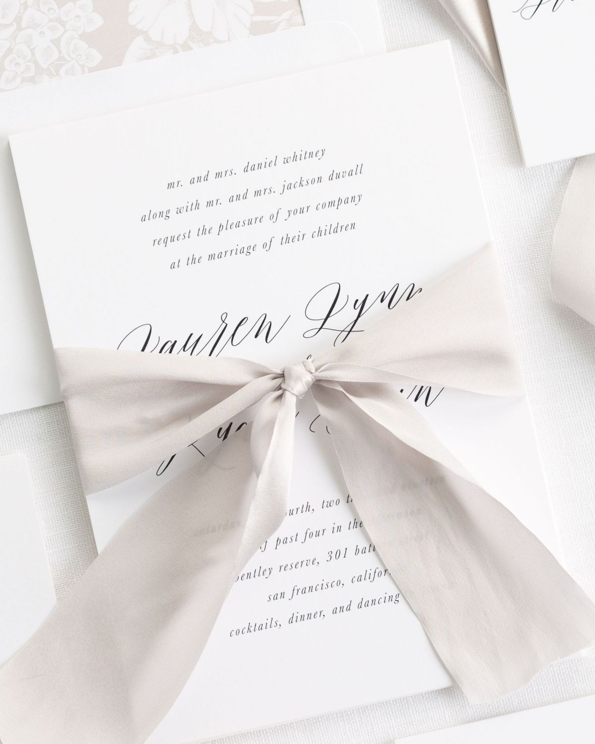 Calligraphy Ribbon Invitations with a floral mocha envelope liner
