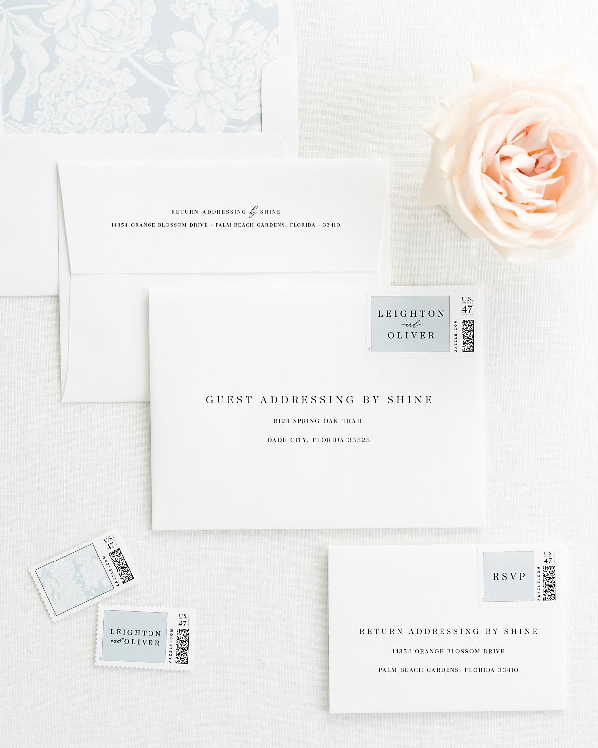 Wedding Invitation Envelopes with Pre-Printed Addresses and Matching Cloud Blue Custom Stamps