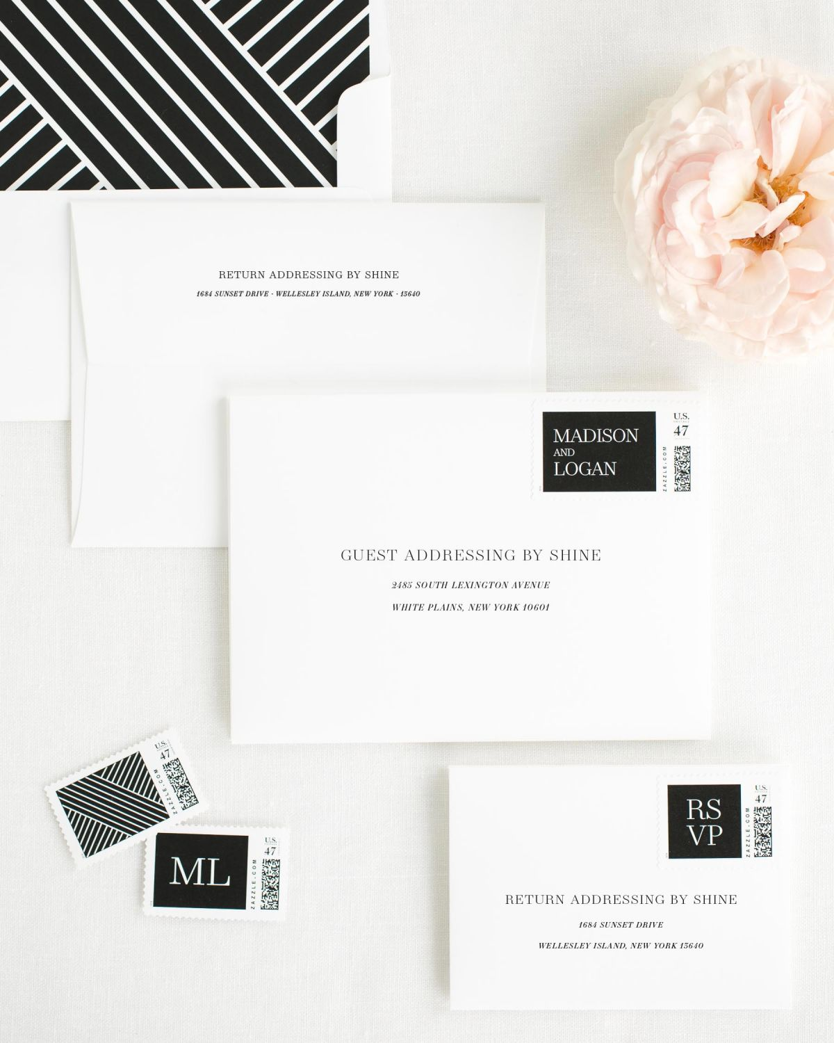 Wedding Invitation Envelopes with Black Custom Stamps and Geometric Liner