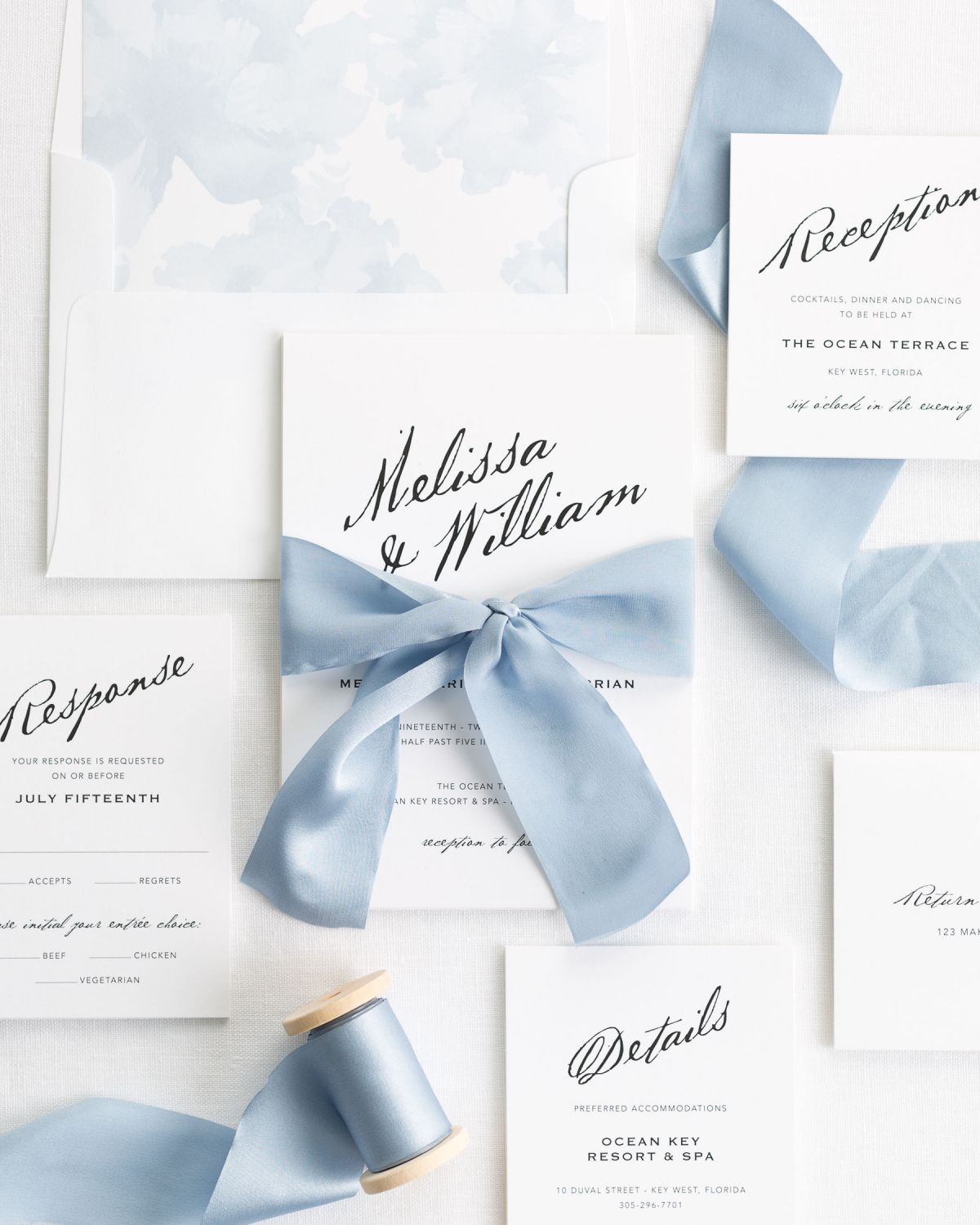 Complete Wedding Invitations with Light Blue Ribbon and Enclosures