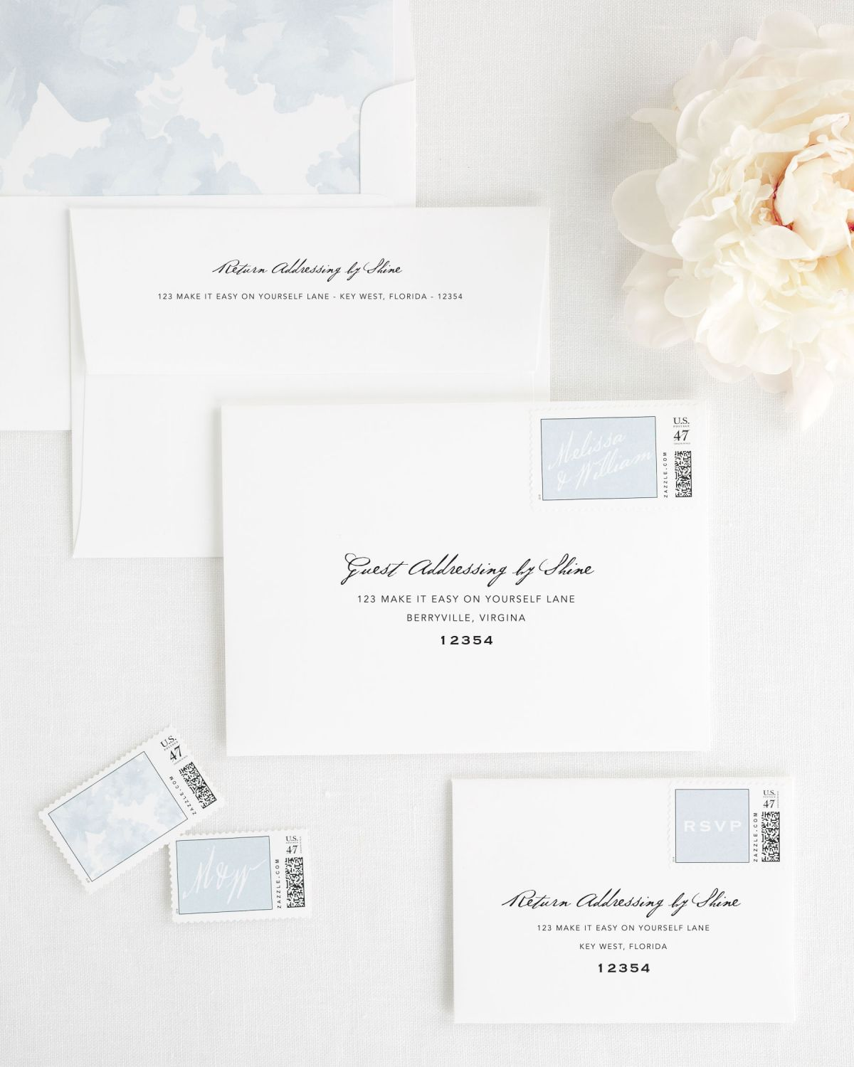 Wedding Invitation Envelopes with Ice Blue Personalized Stamps and Floral Watercolor Liner