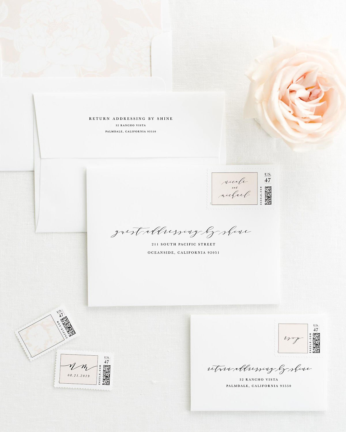 wedding envelopes with guest addressing and custom stamps in sweet pea