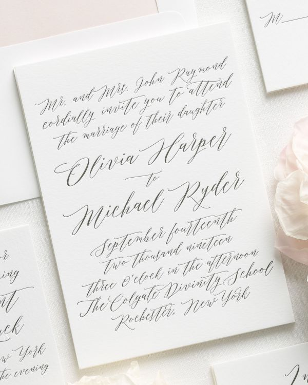 modern calligraphy letterpress wedding invitations with a rose gold liner
