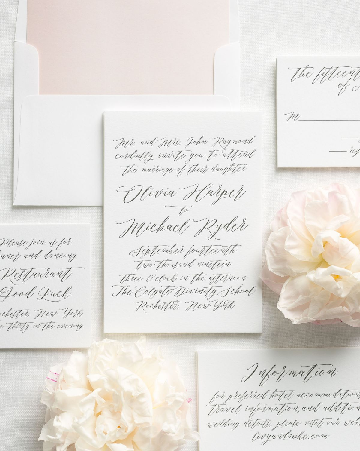 Calligraphy Wedding Invitations with a blush pink watercolor liner