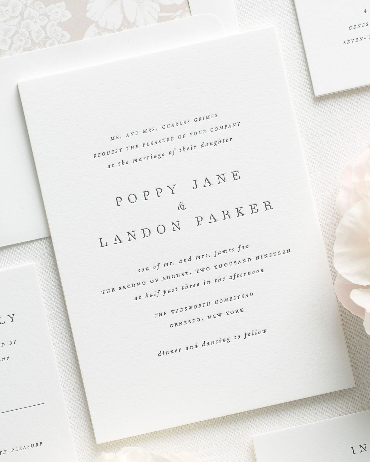 Simple Letterpress Invitations in mocha with a floral envelope liner