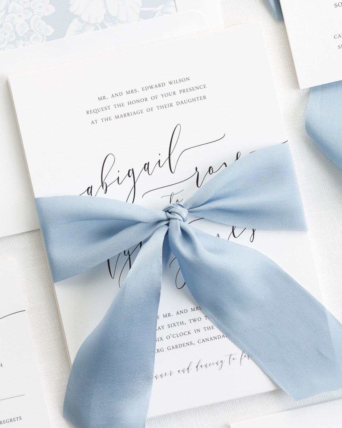Calligraphy Ribbon Invitations with a floral dusty blue envelope liner