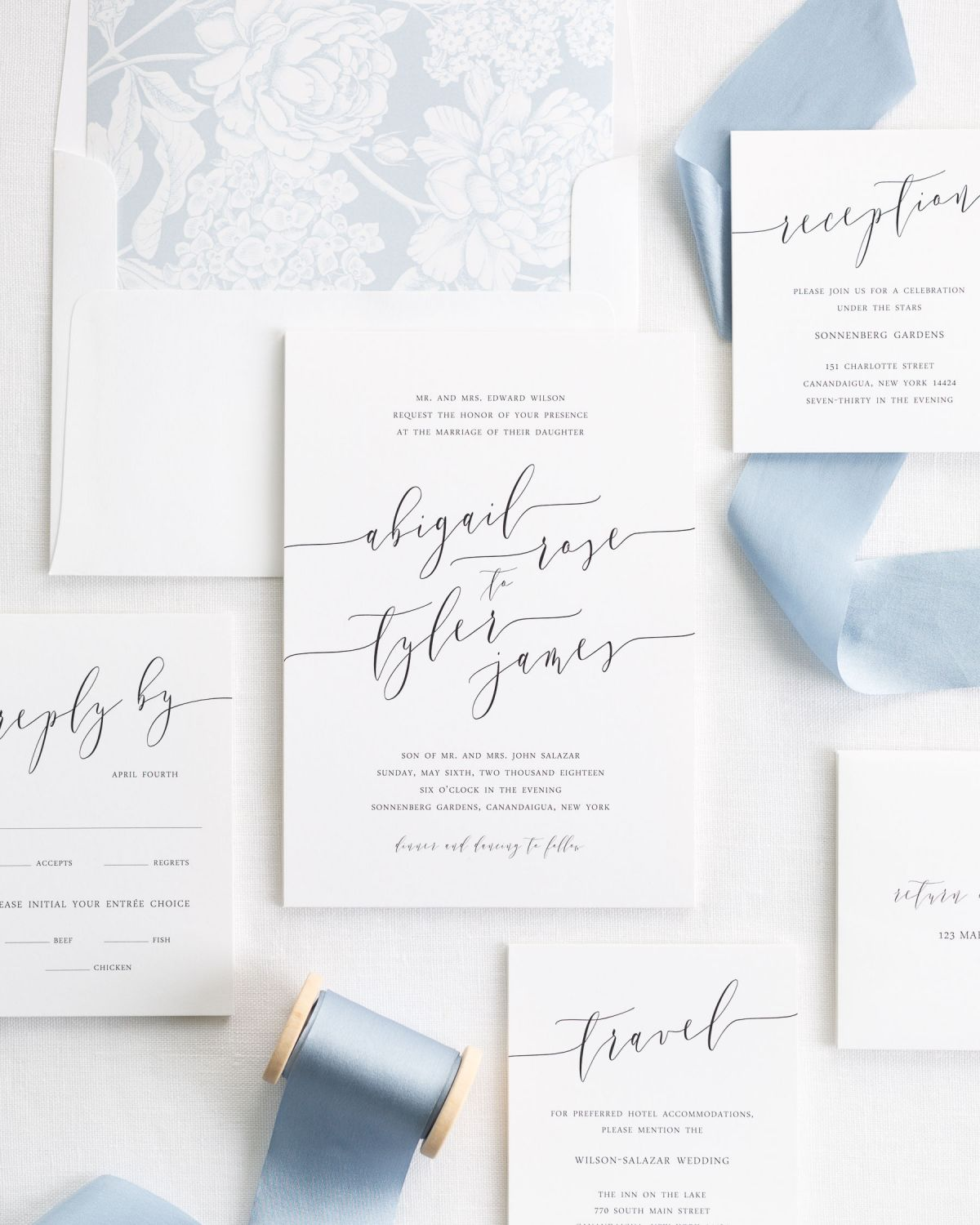 Classic Calligraphy Wedding Invitations with a dusty blue floral envelope liner