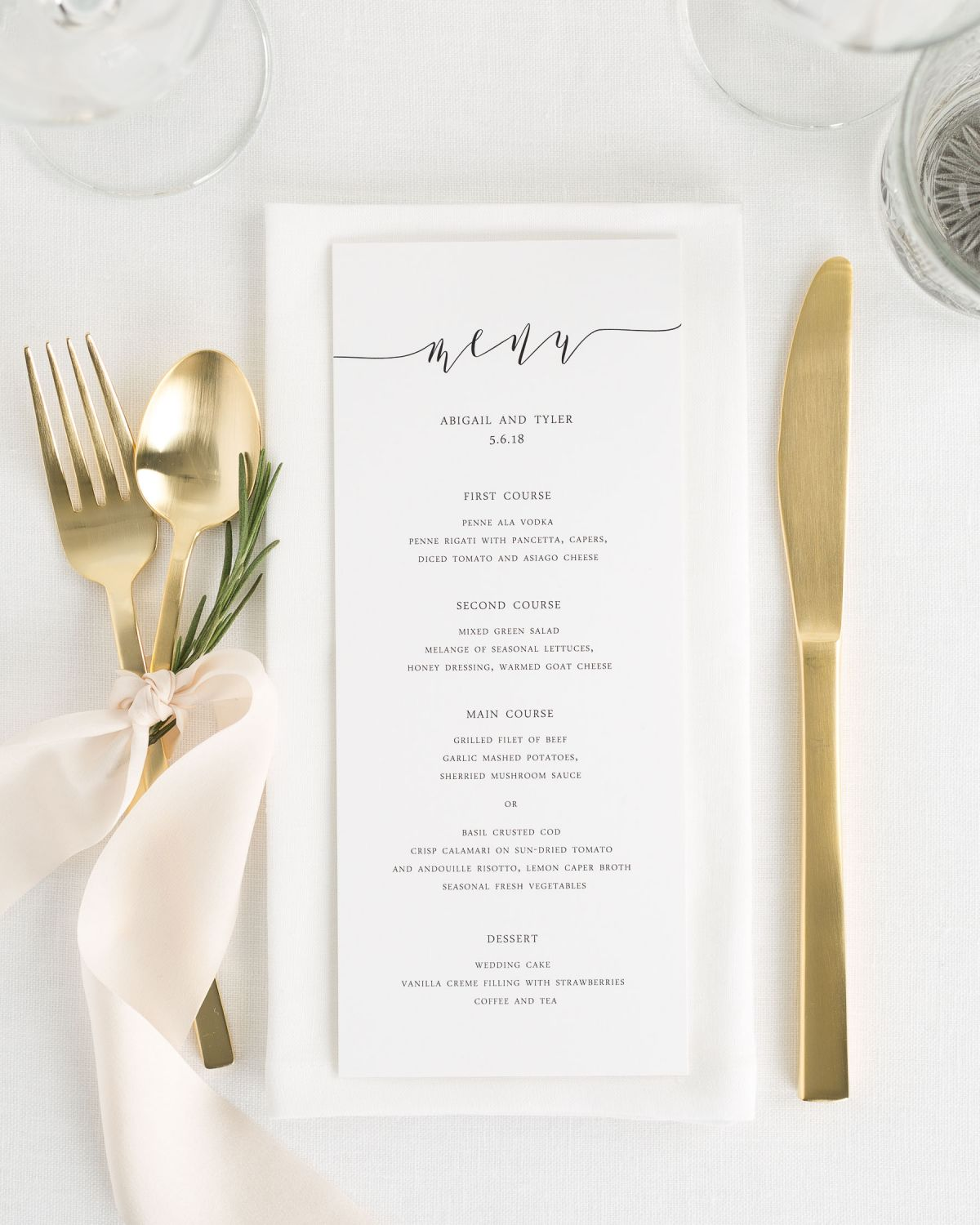 romantic wedding dinner menu with calligraphy and ribbon