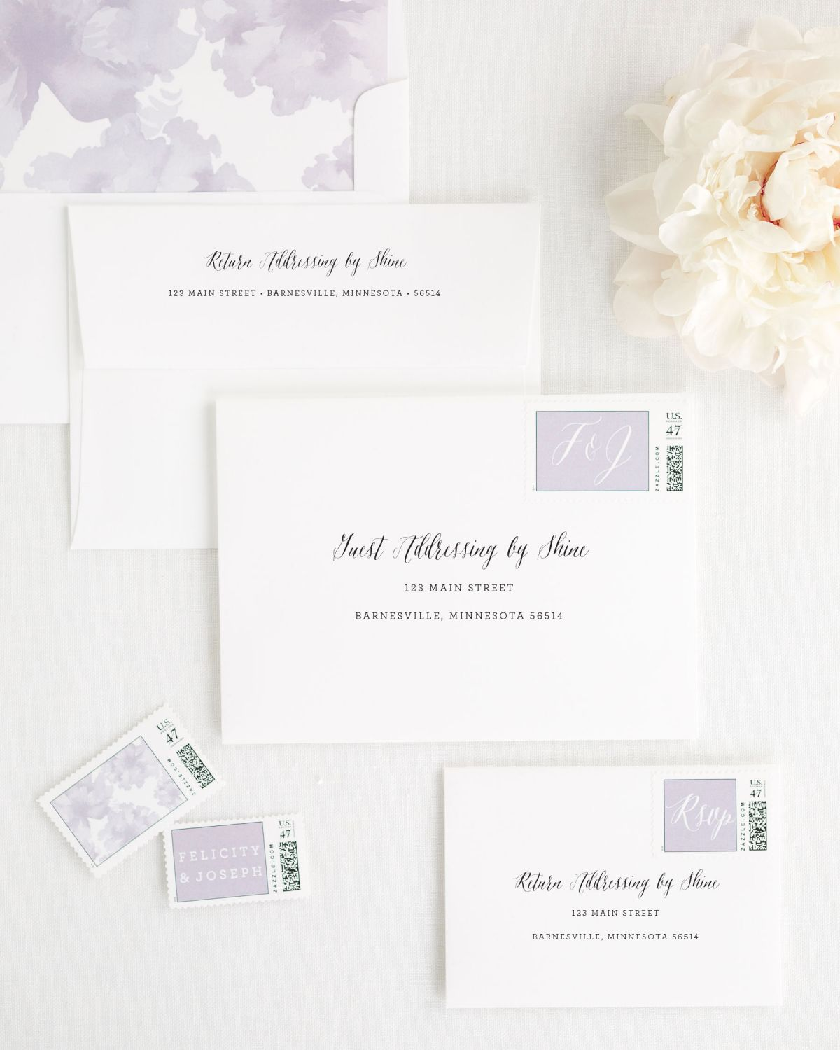 Wedding Invitation Envelopes with Lavander Custom Postage and watercolor peonies