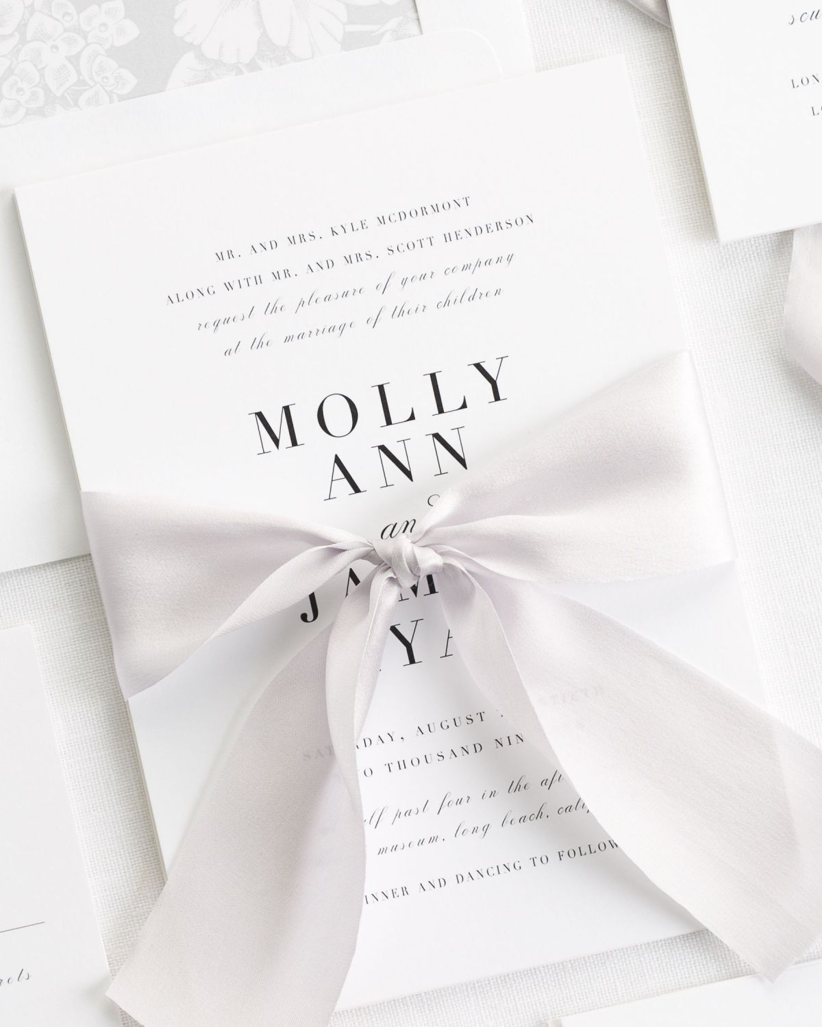 Classic Wedding Invitations with a floral envelope liner in silver gray and platinum silk ribbon