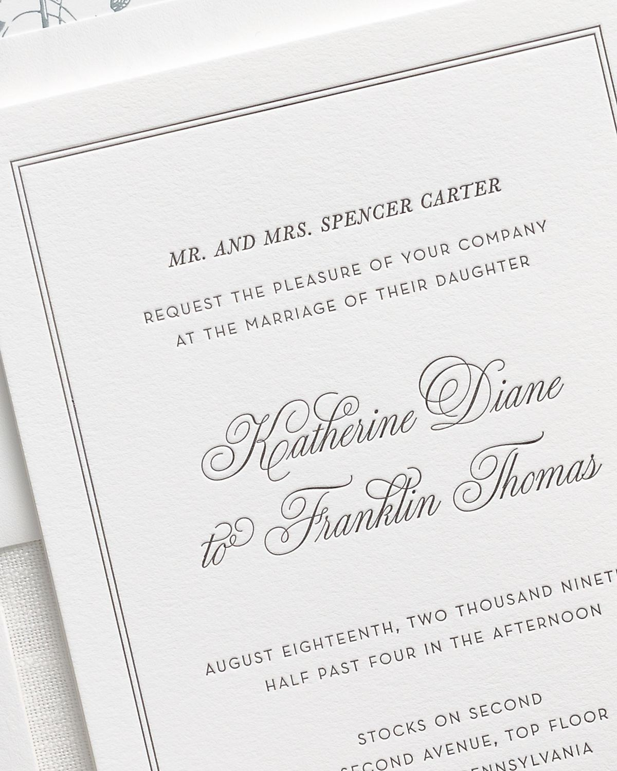 classic and traditional letterpress wedding invitation close up