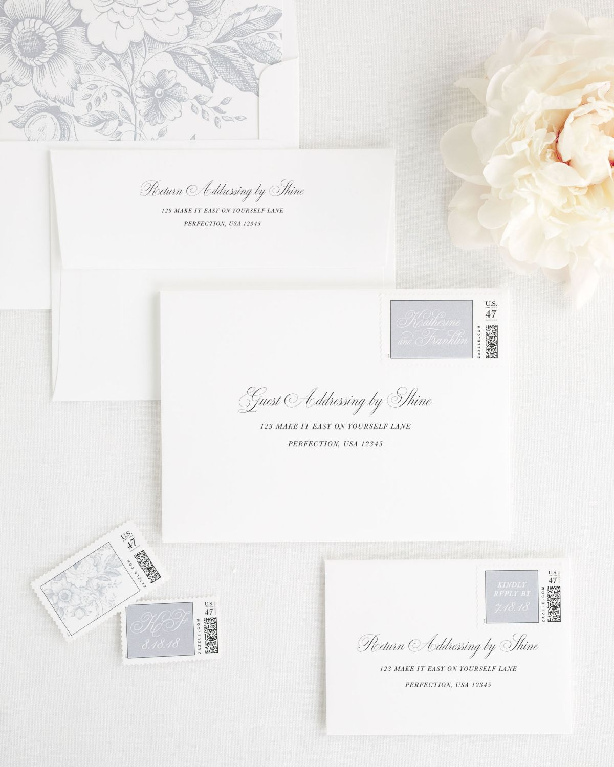 wedding envelopes with guest addressing and custom stamps in dove gray