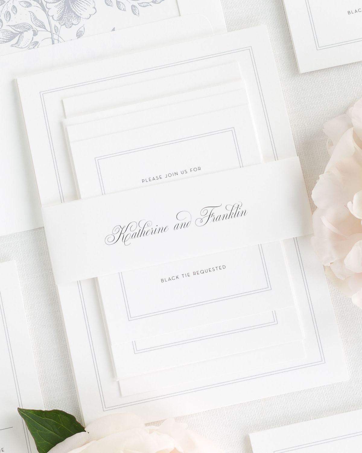 wedding invitations with a simple script belly band