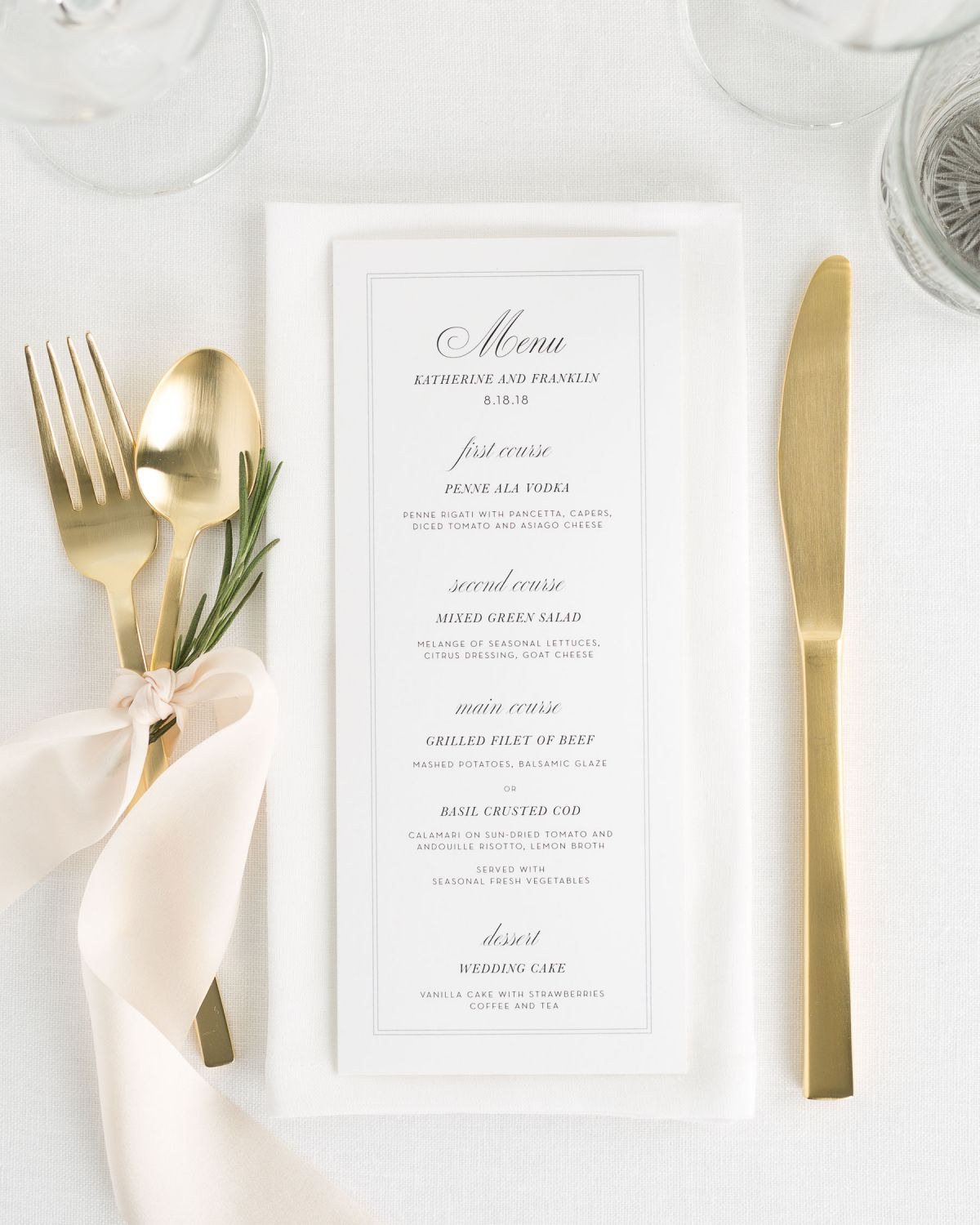 classic wedding menu with gold flatware and pale pink silk ribbon