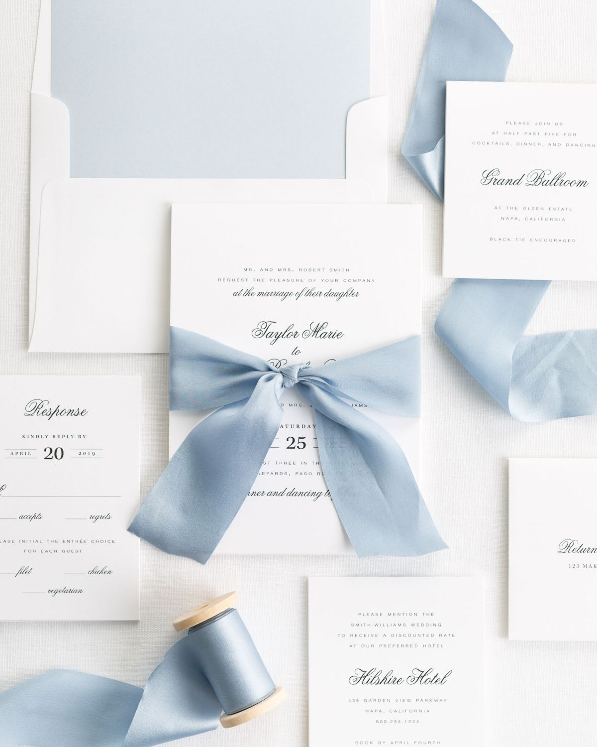 Complete Wedding Invitation Package with Blue Ribbon and Enclosures