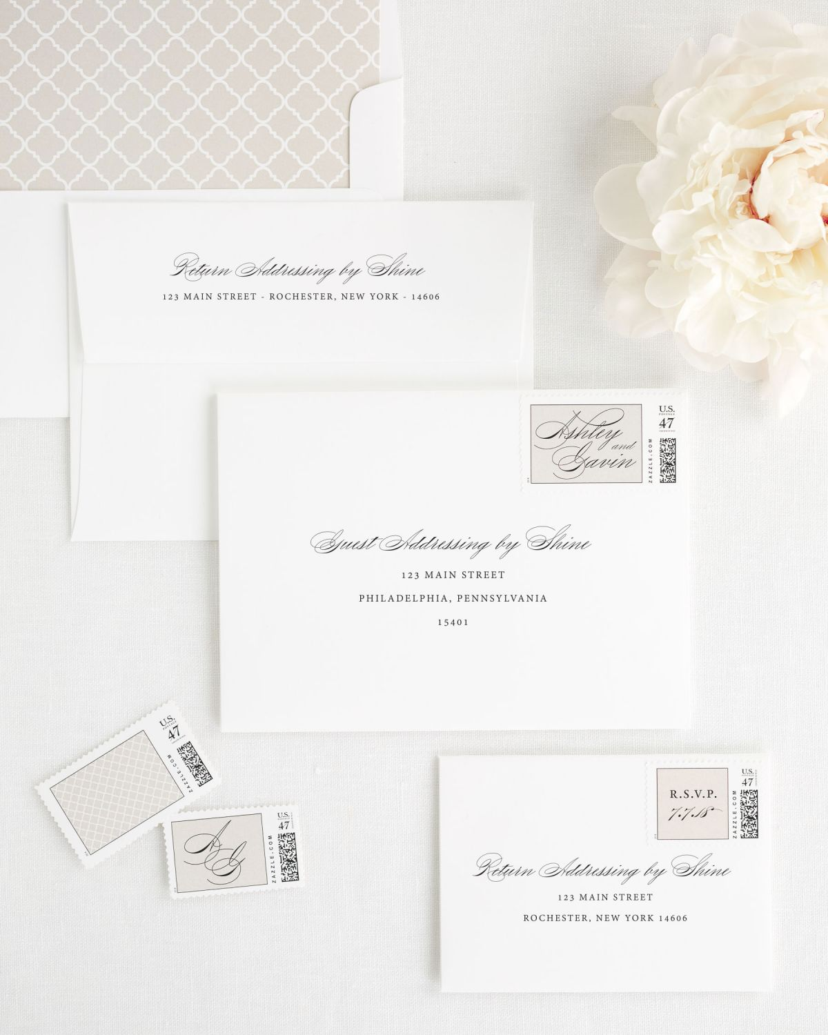 wedding invitation envelopes with custom stamps and trellis pattern liner
