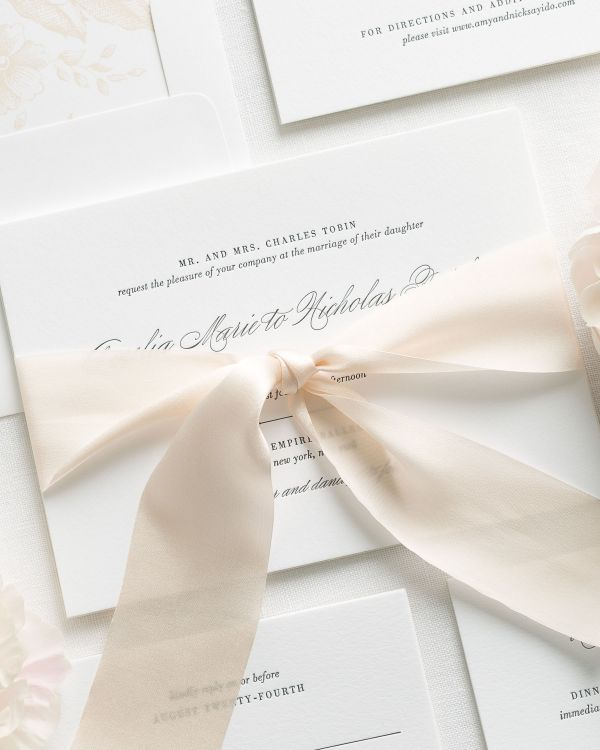 Simple Script Letterpress Invitations in champagne with a floral envelope liner