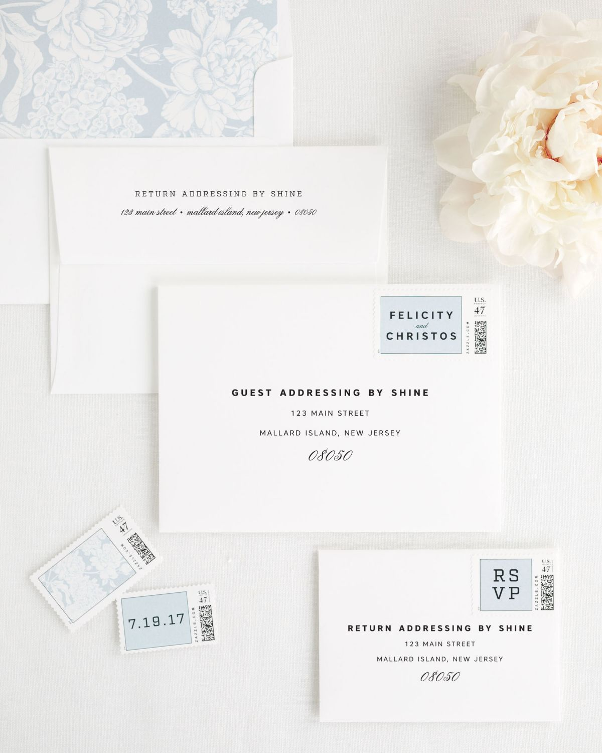 Wedding Invitation Envelopes with Custom Stamps and Blue Liner