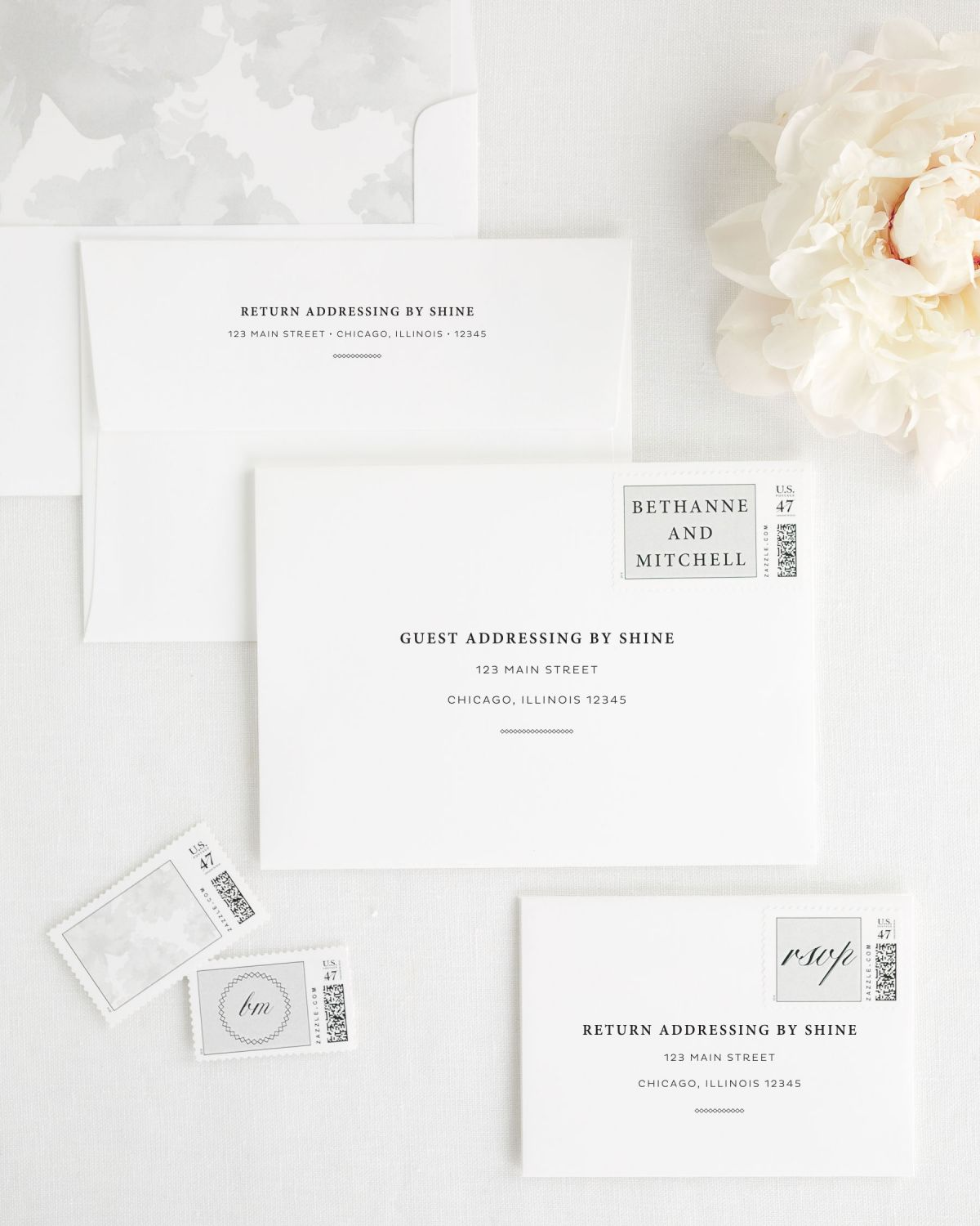 Wedding Invitation Envelopes with Custom Stamps and Light Gray Liner