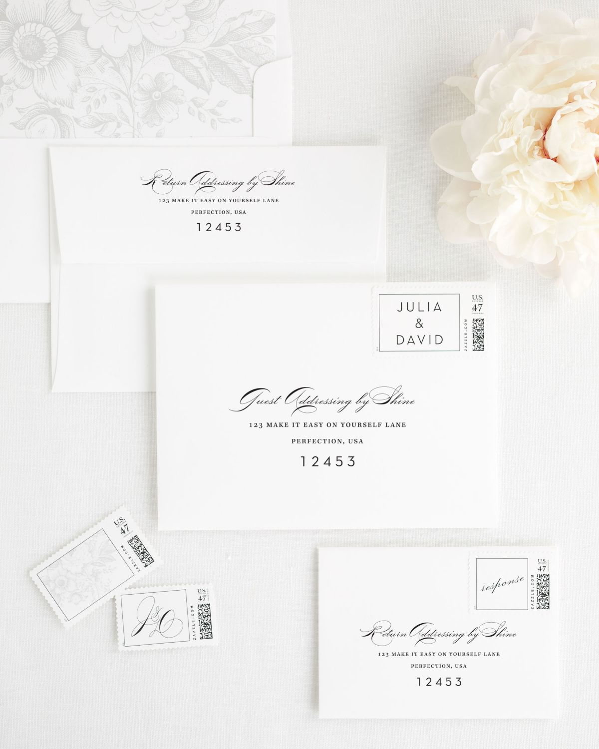 wedding envelopes with guest addressing and custom stamps in silver