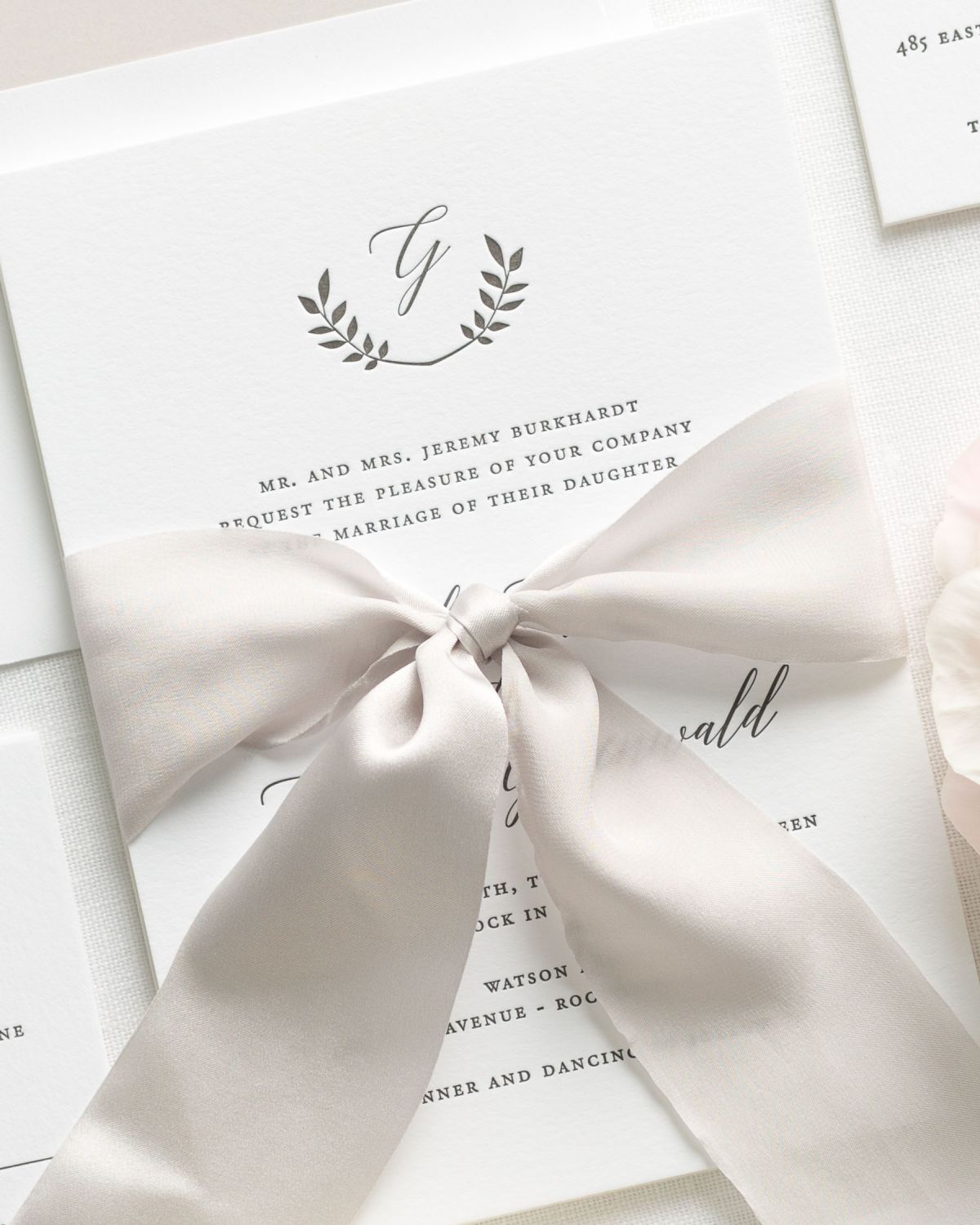 Calligraphy Script Letterpress Invitations with a solid mocha envelope liner