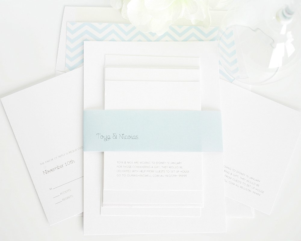Minimalist wedding invitations in light blue