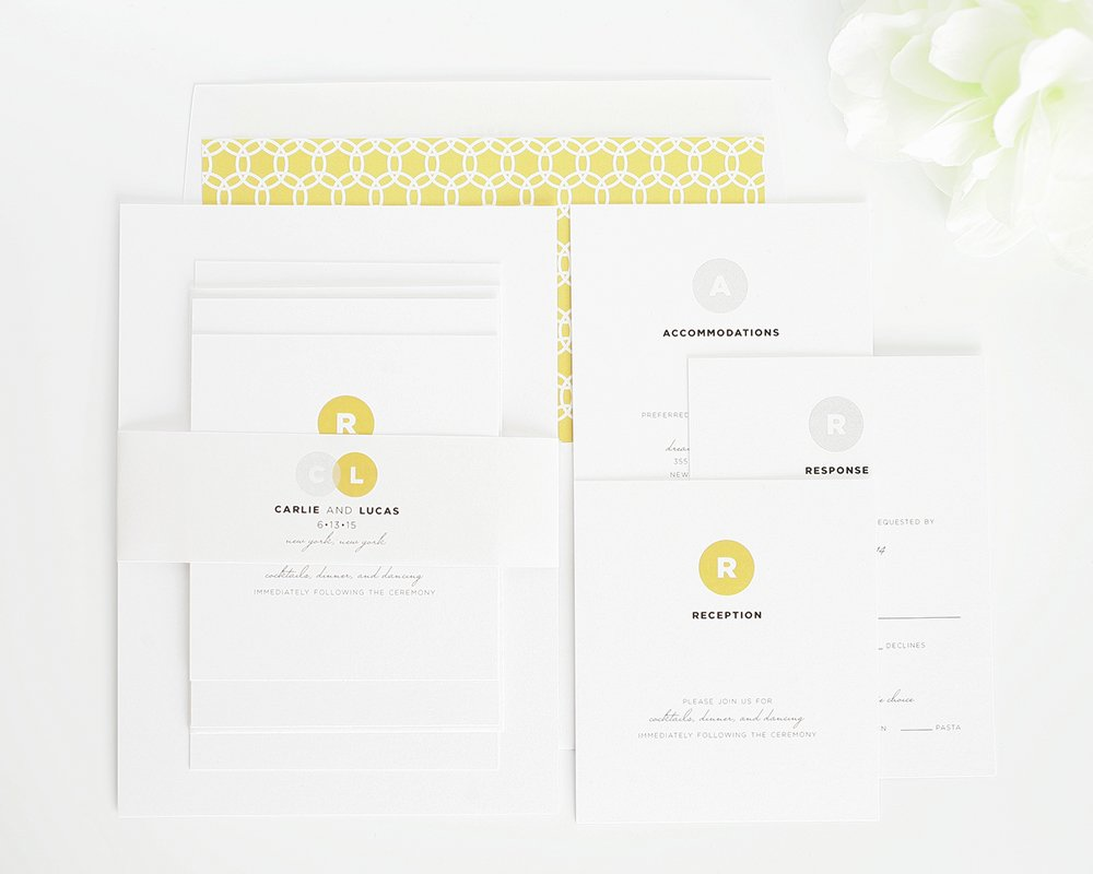 Modern wedding invitations in silver and gold ink