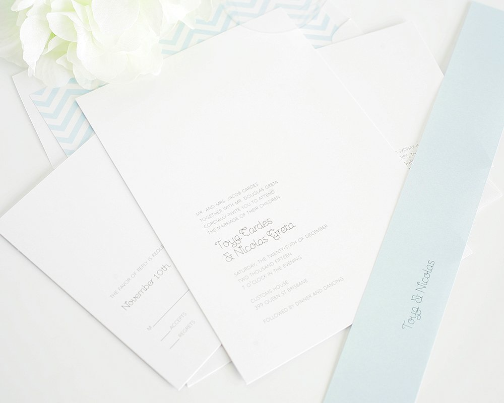 Simple wedding invitations in light blue